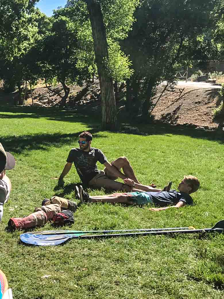 A Boy Scouts Merit Badge counselor shows a group how to give a person first aid during a whitewater and kayaking training class on the Provo River Utah.