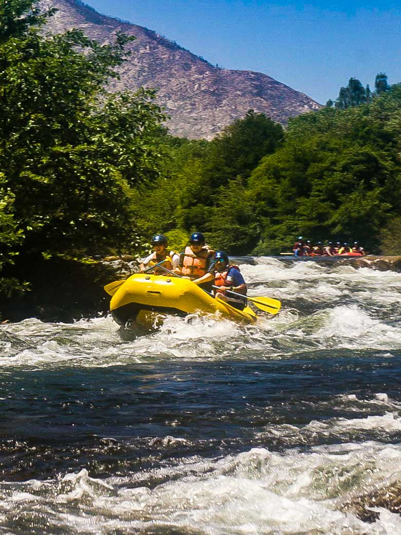 Adults whitewater rafting through Big Daddy rapid on the Kern River near Kernville California.