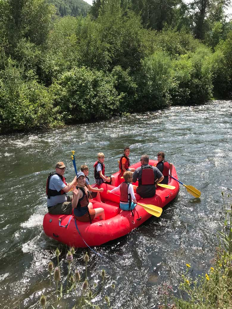 Youth group and Boy Scouts river rafting on the Provo River near Park City Utah.