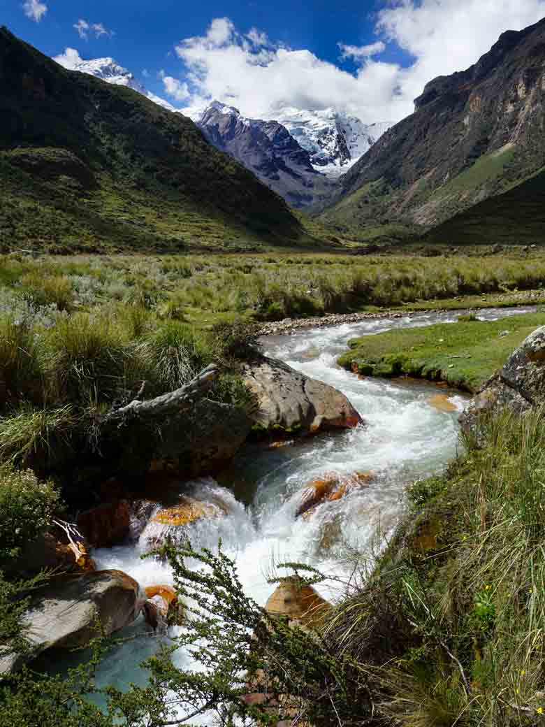 A river flowing from the mountains seen on a custom whitewater rafting trip in Peru.