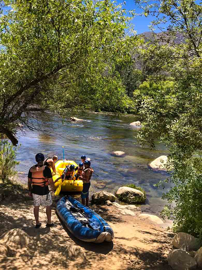 Men rafting and kayaking on the Kern River in California.