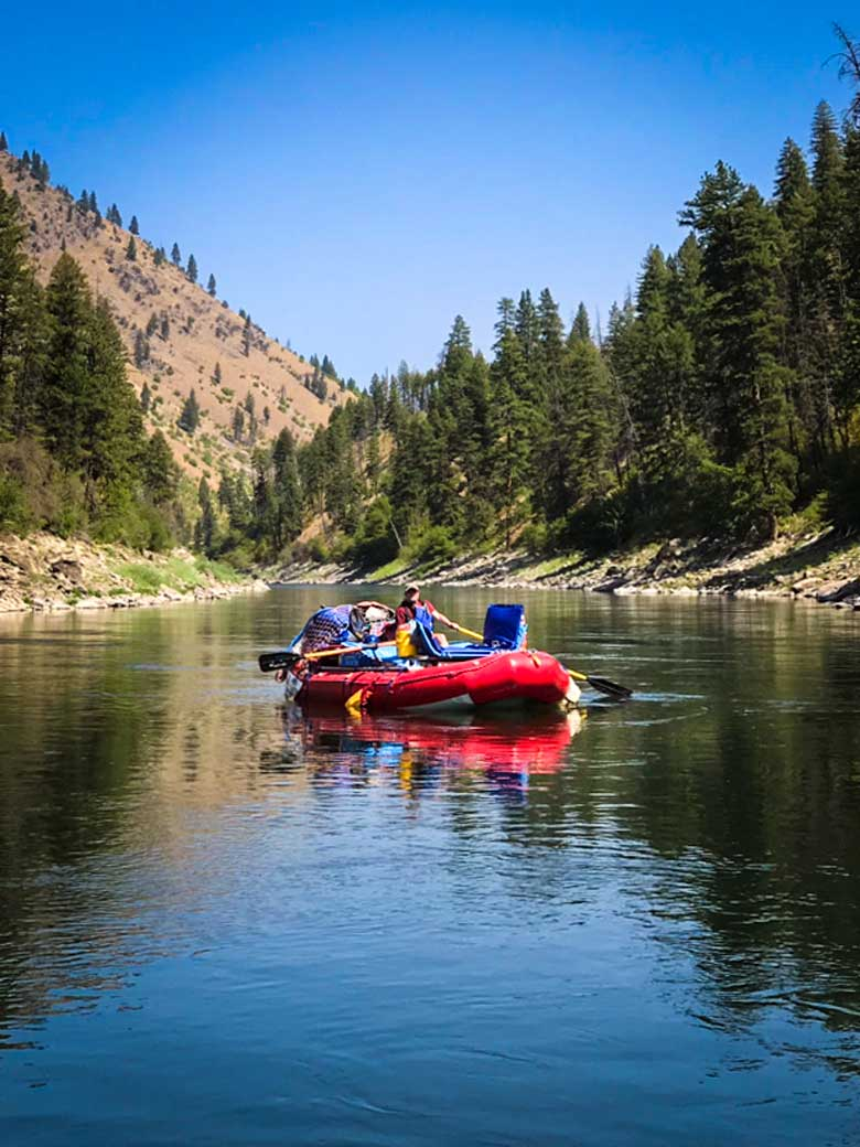 A man rafting during a Main Salmon River whitewater rafting vacation in Idaho.