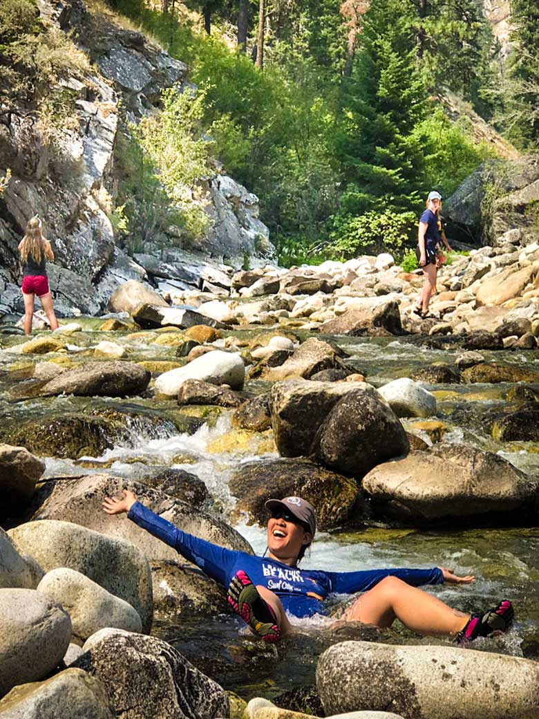 Three girls playing in a creek during a Main Salmon River Whitewater rafting vacation in Idaho.