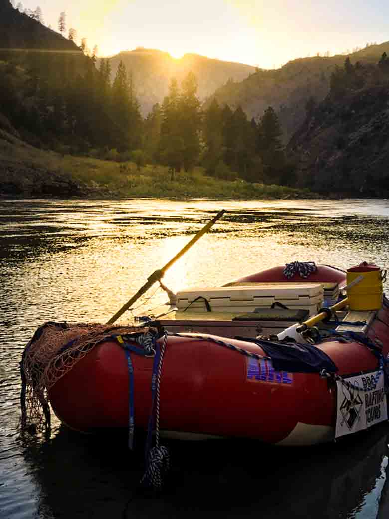 A raft in great condition at sunset at camp during a Main Salmon River whitewater rafting vacation in Idaho.