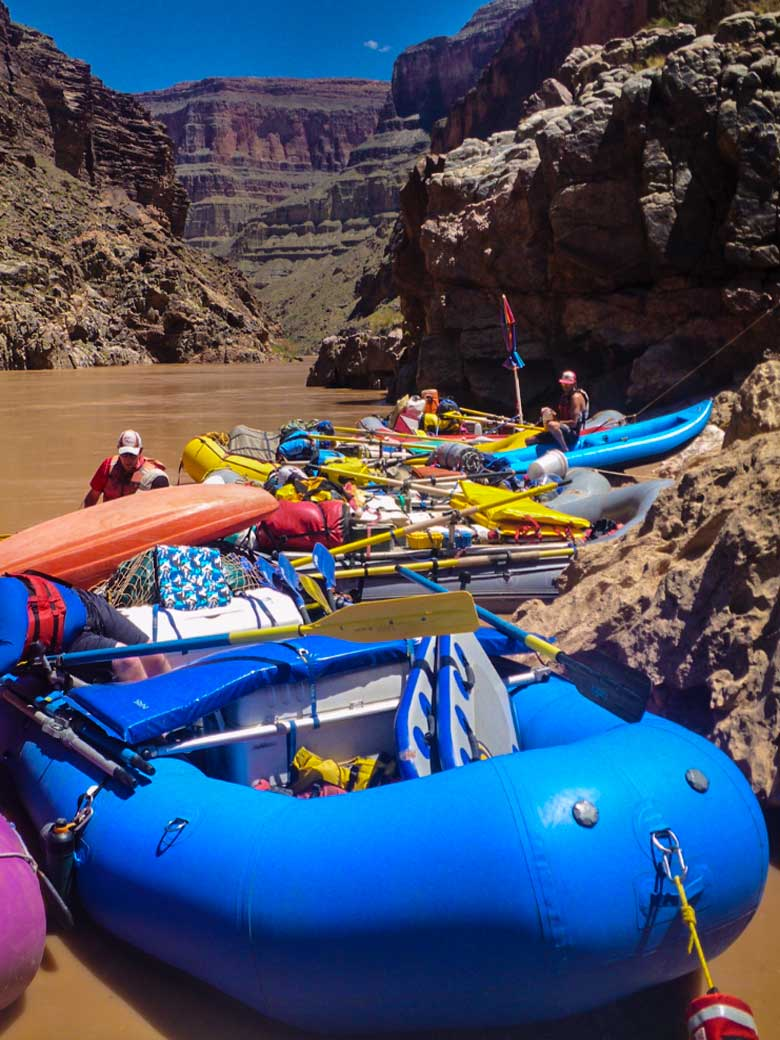Rafts in good condition line a beach on the Colorado River in the Grand Canyon Arizona.