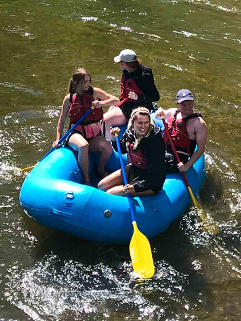 A group of four during a raft rental trip on the Provo River near Provo & Park City, Utah.