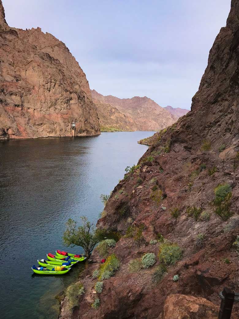 View of four kayaks on the Colorado River during a kayak trip on the Colorado River in Arizona near the Grand Canyon National Park.