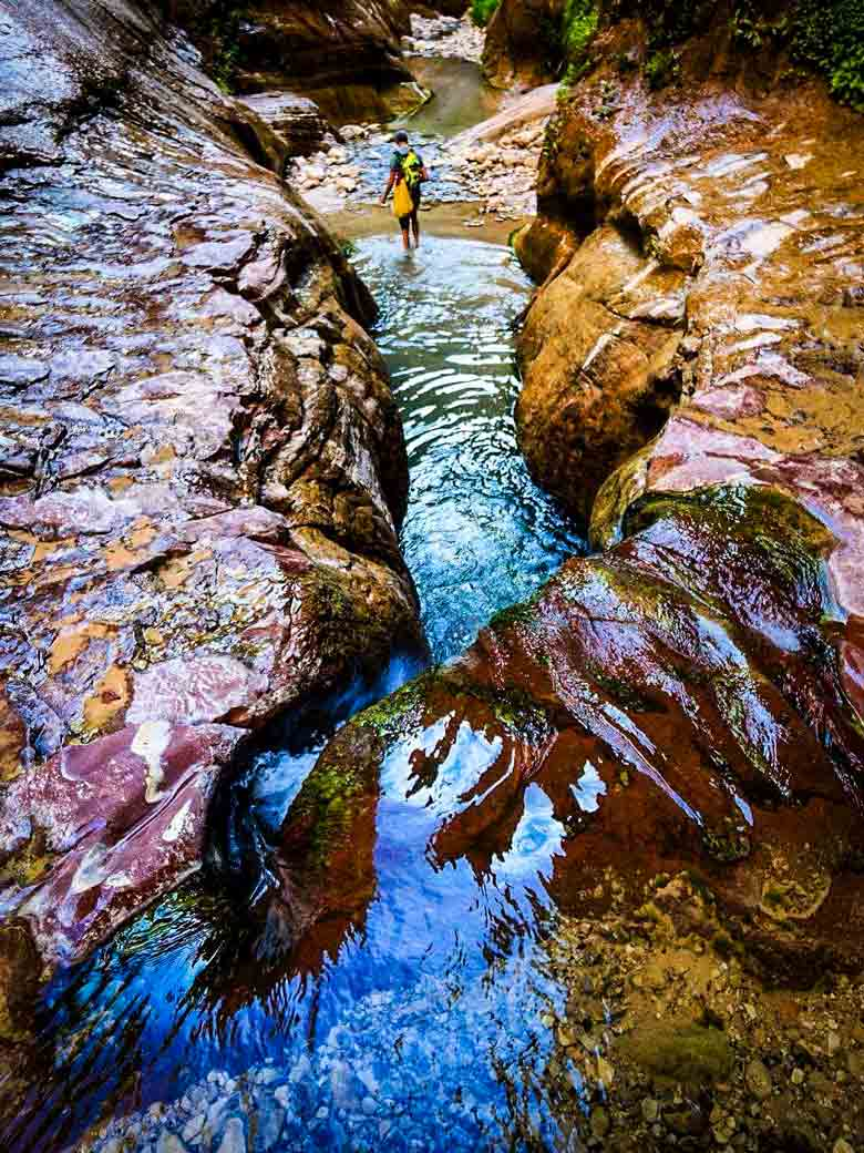 Following a colorful river canyon during an exploratory trip in Southern Utah.
