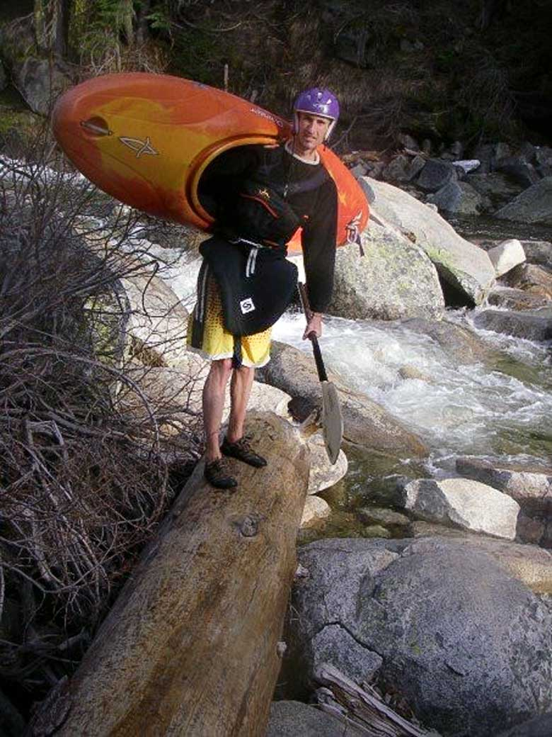 Donny carrying his kayak on the Strawberry to Kyburz run on the South Fork of the American River, California.