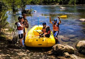 Guests with a river guide during a guided whitewater rafting trip on the Kern River, Kernville California.
